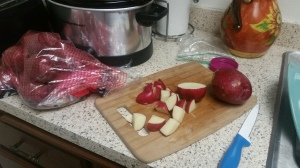 chopping red potatoes